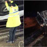 Un policía evita con sus manos que un camión caiga por un puente