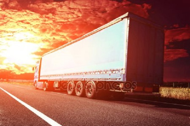 depositphotos 129805222 stock photo truck on road in sunset